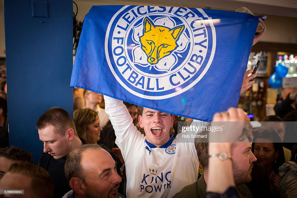 Leicester City fans celebrate a draw against Manchester United in The Market Tavern on May 1st, 2016 in Leicester, England. Leicester City can have won the Premier League title today if they had beaten Manchester United away at Old Trafford. Leicester City will be crowned champions on Monday if Tottenham Hotspur fail to win on Monday in what would be one of the league's most surprising and memoriable moments.