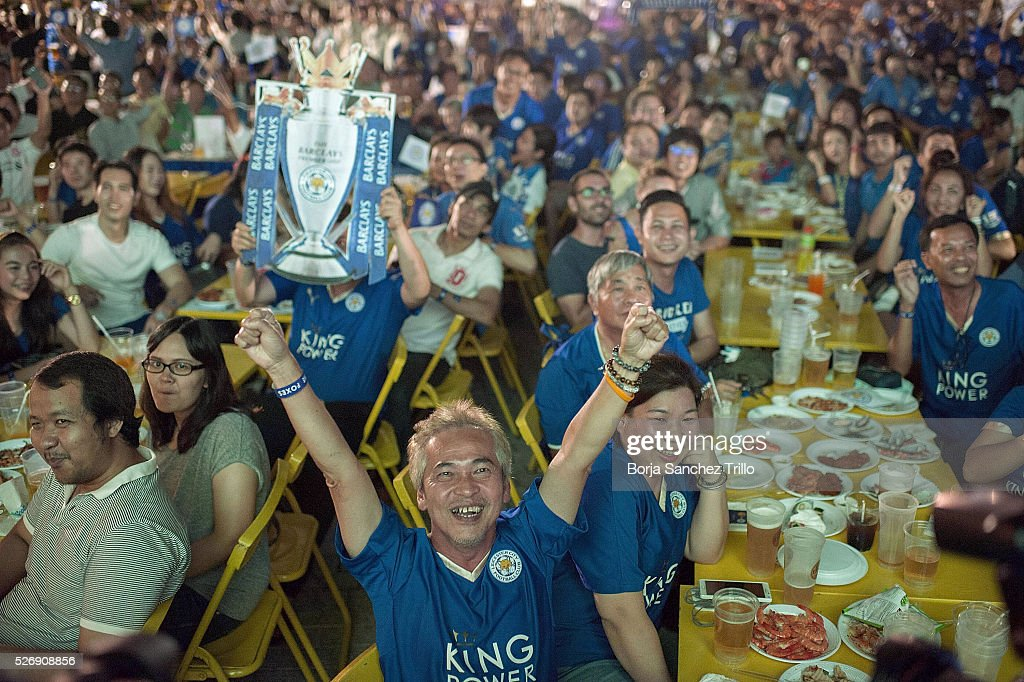 Leicester City fans celebrate a goal while watching their team play against Manchester United at King Power Hotel on May 1, 2016 in Bangkok, Thailand.