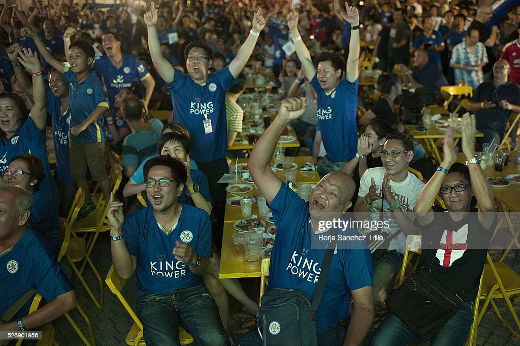 Leicester city fans celebrate a goal while watching their team plays against Manchester United on May 1, 2016 in Bangkok, Thailand. Leicester City fans gather at King Power Hotel in Bangkok to watch the Premier League game between Manchester United and Leicester City at Old Trafford.