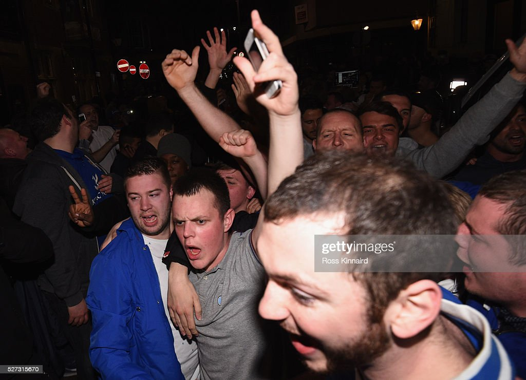 Leicester City fans celebrate as their team becomes Premier League champions after watching the Barclays Premier League between Chelsea and Tottenham Hotspur on May 2, 2016 in Leicester, United Kingdom. Spurs' failure to win against Chelsea tonight sees Leicester City claim their first ever top flight title.