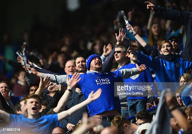 Leicester City fans celebrate as Wes Morgan of Leicester City scores their first goal during the Barclays Premier League match between Leicester City...