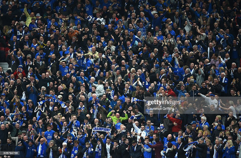 Leicester City fans celebrate the goal scored by Wes Morgan during the Barclays Premier League match between Manchester United and Leicester City at Old Trafford on May 1, 2016 in Manchester, England.