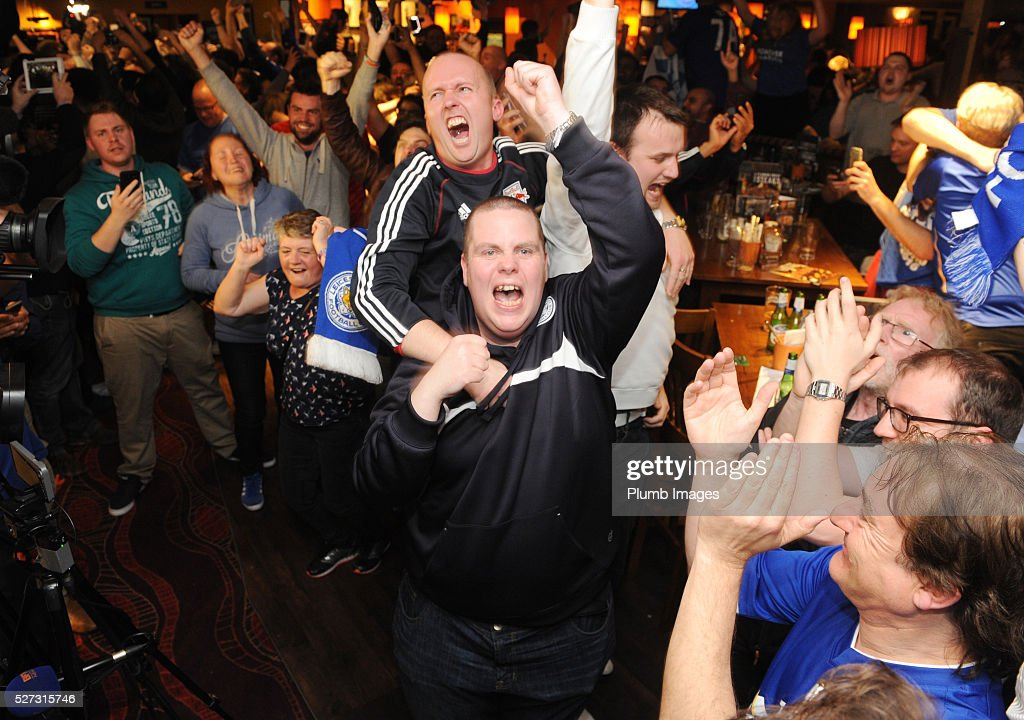 Leicester City Fans celebrate their team becoming Premier League champions, as they watch Tottenham Hotspur play Chelsea, at The Local Hero pub on Freemans Common on May 2, 2016 in Leicester, United Kingdom.