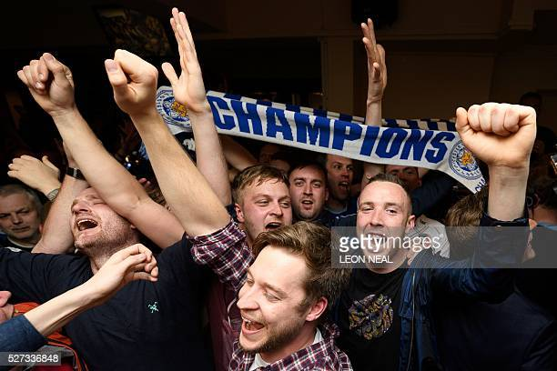 Leicester City fans celebrate their team becoming the English Premier League champions in central Leicester eastern England on May 2 2016 after...