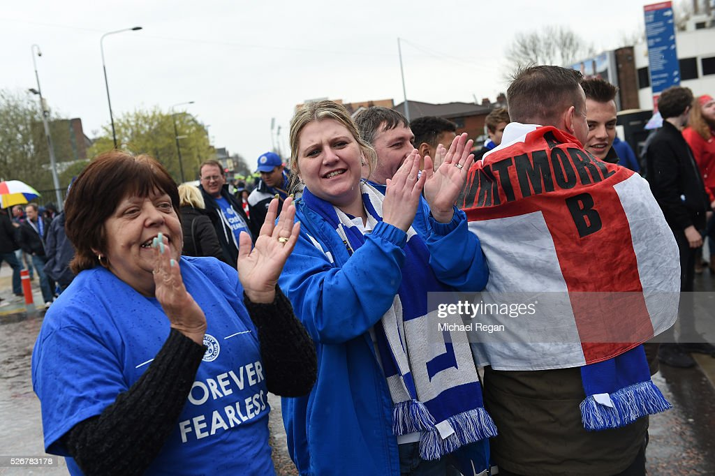 Leicester City fans cheer outside the ground prior to the Barclays Premier League match between Manchester United and Leicester City at Old Trafford on May 1, 2016 in Manchester, England.