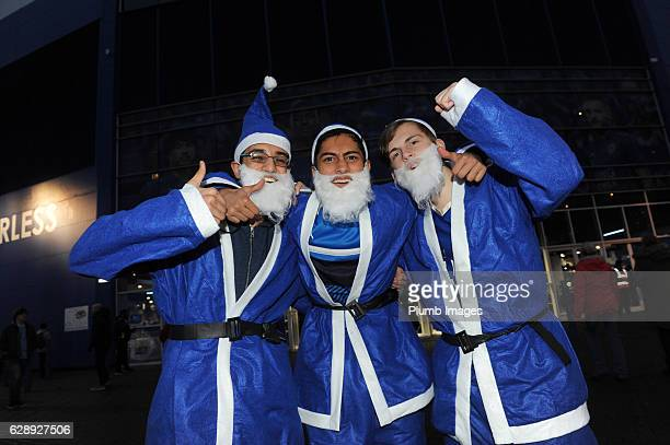 Leicester City fans dressed as Santa Claus at King Power Stadium ahead of the Premier League match between Leicester City and Manchester City at King...