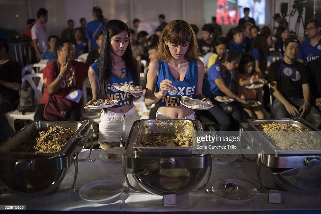 Leicester City fans get some food during the break of Manchester United and Leicester City match on May 1, 2016 in Bangkok, Thailand. Leicester City fans gather at King Power Hotel in Bangkok to watch the Premier League game between Manchester United and Leicester City at Old Trafford.