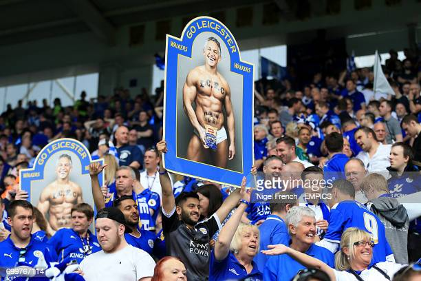 Leicester City fans in the stands hold a banner reminding Gary Lineker of his promise to present Match of the Day in his pants