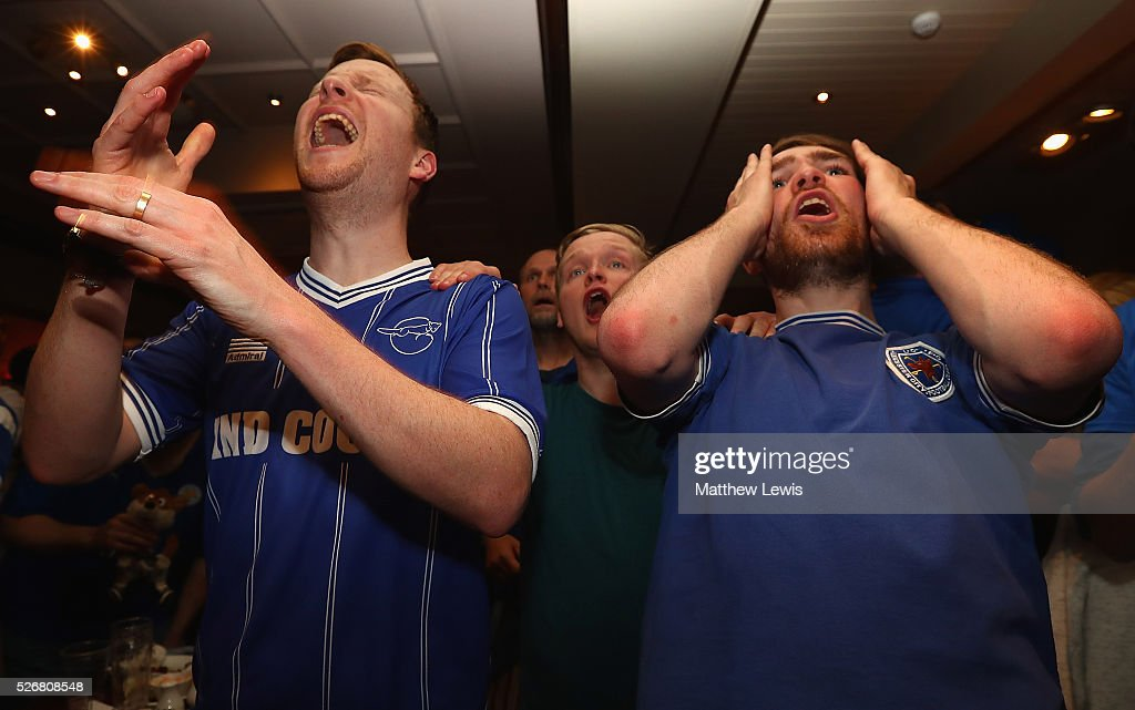 Leicester City fans look on, as they gather in the Local Hero pub to watch their match against Manchester United on May 1, 2016, 2016 in Leicester, England.