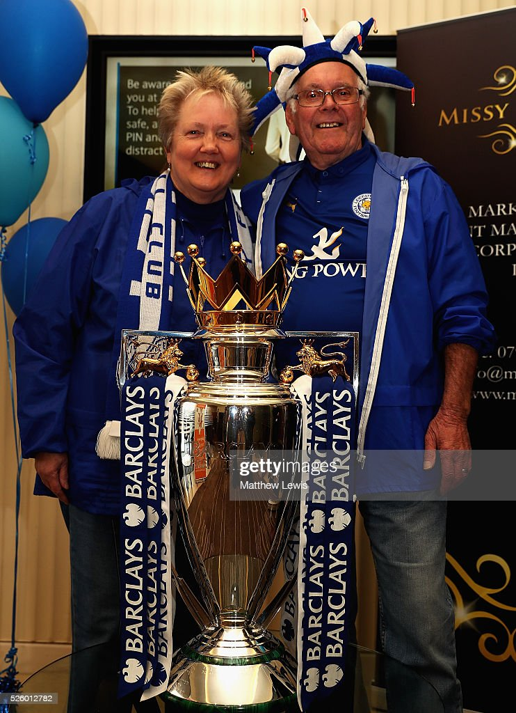 Leicester City fans Mary and Barry Reeves pictured with the Barclays Premier League Trophy in a Barclays Bank during a Leicester Backing the Blues Campaign in support of Leicester City on April 29, 2016 in Leicester, England.