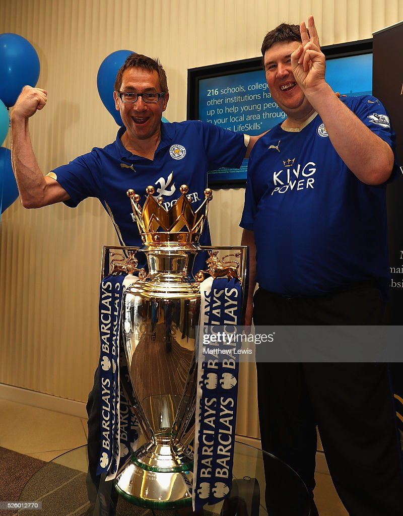 Leicester City fans Pete Williams and John Atkinson pictured with the Barclays Premier League Trophy in a Barclays Bank during a Leicester Backing the Blues Campaign in support of Leicester City on April 29, 2016 in Leicester, England.