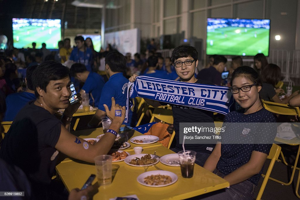 Leicester city fans pose for a picture before watching their team plays against Manchester United on May 1, 2016 in Bangkok, Thailand. Leicester City fans gather at King Power Hotel in Bangkok to watch the Premier League game between Manchester United and Leicester City at Old Trafford.