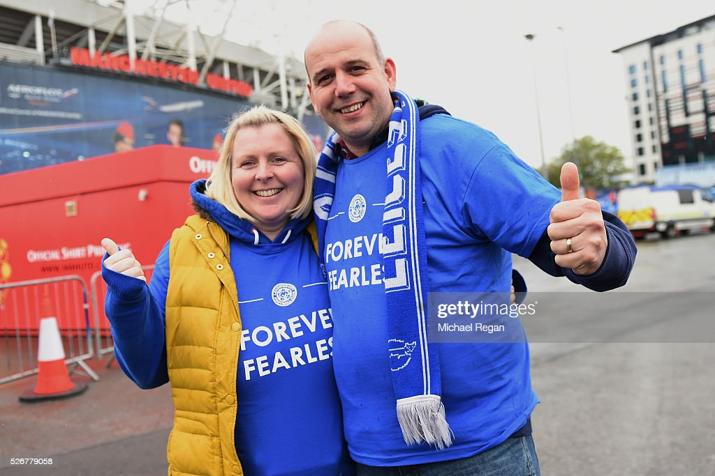 Leicester City fans pose outside the ground prior to the Barclays Premier League match between Manchester United and Leicester City at Old Trafford on May 1, 2016 in Manchester, England.
