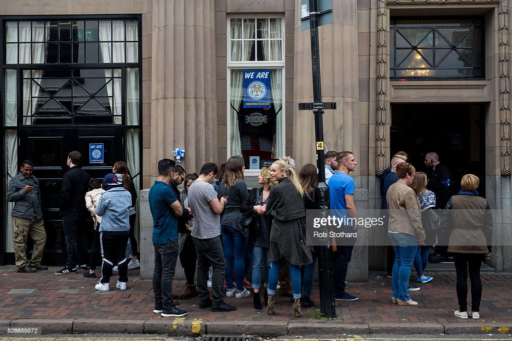 Leicester City fans queue outside a pub in the city centre on May 1st, 2016 in Leicester, England. Leicester City can win the Premier League title today if they beat Manchester United away at Old Trafford in what would be one of the league's most surprising and memoriable moments.