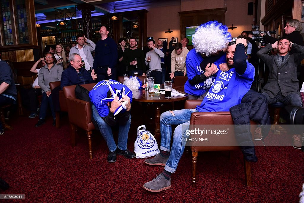 Leicester City fans react after a missed chance for Chelsea during the English Premier League football match between Chelsea and Tottenham Hotspur in a pub in central Leicester, eastern England, on May 2, 2016. Leicester City's remarkable football season could see them crowned champions of England for the first time in their 132-year history without kicking a ball on May 2 if second-placed Tottenham Hotspur fail to keep the Premier League title race alive. Anything less than a Spurs victory away to London rivals Chelsea at Stamford Bridge (1900GMT) -- a ground where they haven't enjoyed a league win for 26 years -- will see Claudio Ranieri's men, 5,000/1 outsiders in pre-season, complete a stunning triumph. NEAL