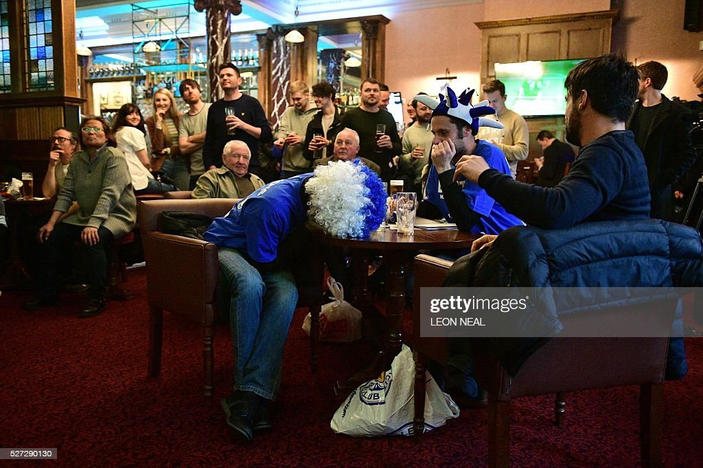 Leicester City fans react in the first half as they watch the English Premier League football match between Chelsea and Tottenham Hotspur in a pub in central Leicester, eastern England, on May 2, 2016. Leicester City's remarkable football season could see them crowned champions of England for the first time in their 132-year history without kicking a ball on May 2 if second-placed Tottenham Hotspur fail to keep the Premier League title race alive. Anything less than a Spurs victory away to London rivals Chelsea at Stamford Bridge (1900GMT) -- a ground where they haven't enjoyed a league win for 26 years -- will see Claudio Ranieri's men, 5,000/1 outsiders in pre-season, complete a stunning triumph. NEAL