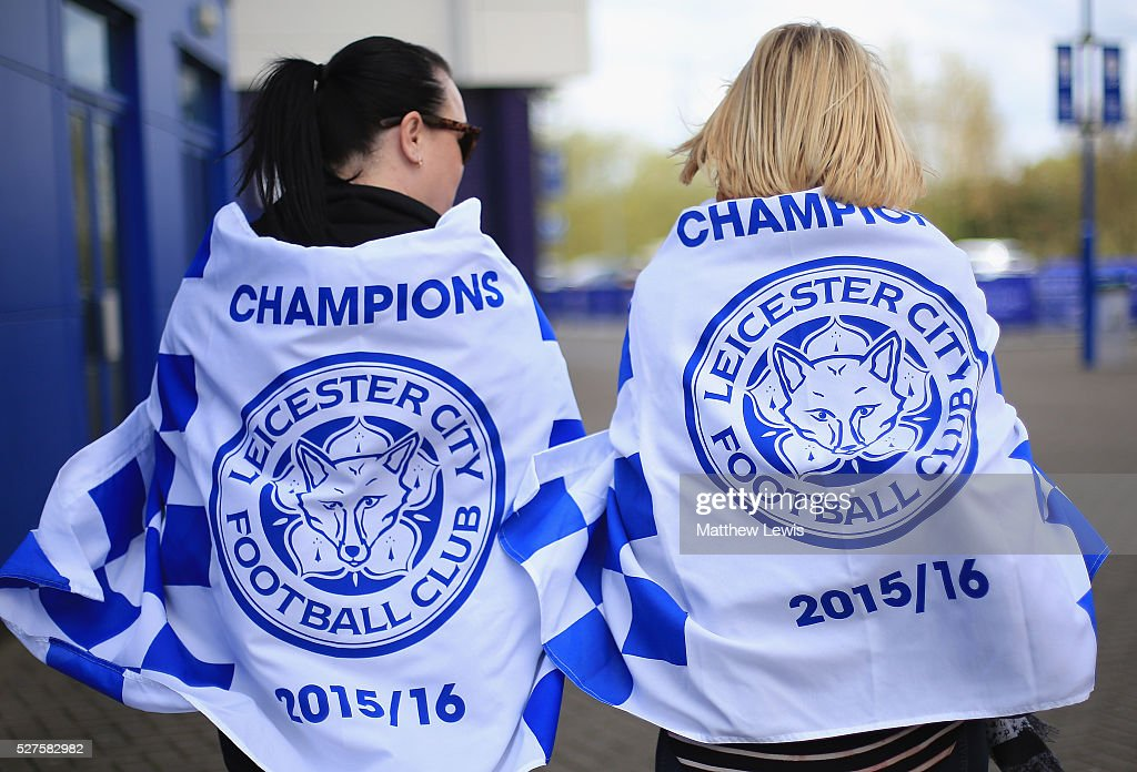Leicester City fans react to Leicester City's Premier League Title Success on May 03, 2016 in Leicester, England.