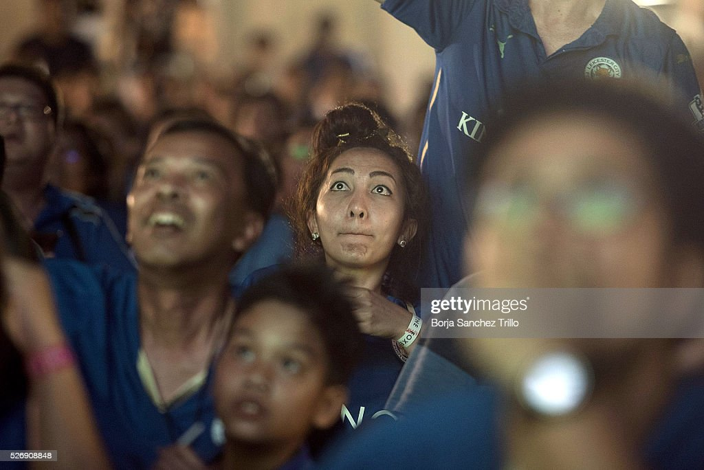 Leicester City fans react while watching their team play against Manchester United at King Power Hotel on May 1, 2016 in Bangkok, Thailand.