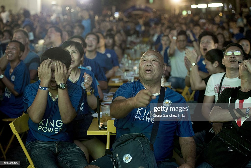 Leicester city fans react while watching their team play against Manchester United on May 1, 2016 in Bangkok, Thailand. Leicester City fans gather at King Power Hotel in Bangkok to watch the Premier League game between Manchester United and Leicester City at Old Trafford.