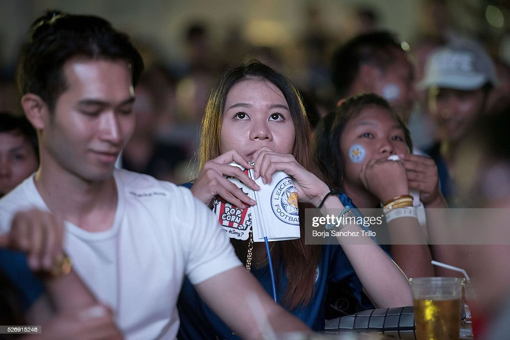 Leicester city fans react while watching their team plays against Manchester United on May 1, 2016 in Bangkok, Thailand. Leicester City fans gather at King Power Hotel in Bangkok to watch the Premier League game between Manchester United and Leicester City at Old Trafford.