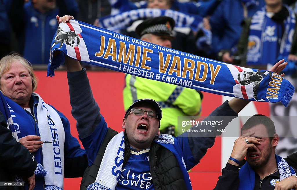 Leicester City fans show their support during the Barclays Premier League match between Manchester United and Leicester City at Old Trafford on May 1, 2016 in Manchester, United Kingdom.