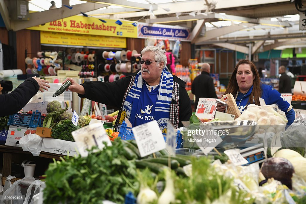 Leicester City fans show their support in a local market on April 29, 2016 in Leicester, England.