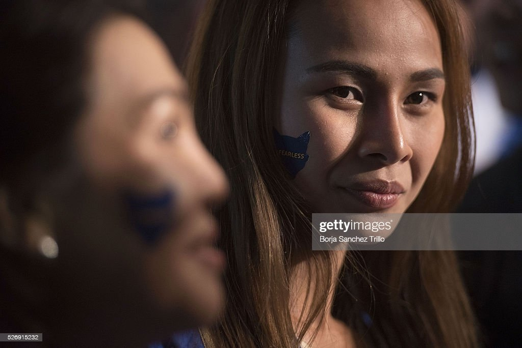 Leicester city fans talk to the media while watching their team plays against Manchester United on May 1, 2016 in Bangkok, Thailand. Leicester City fans gather at King Power Hotel in Bangkok to watch the Premier League game between Manchester United and Leicester City at Old Trafford.