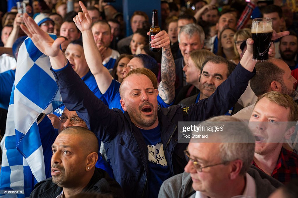 Leicester City fans watch the game against Manchester United in The Market Tavern on May 1, 2016 in Leicester, England. Leicester City would have won the Premier League title today if they had beaten Manchester United away at Old Trafford. Leicester City will be crowned champions on Monday if Tottenham Hotspur fail to win on Monday in what would be one of the league's most surprising and memoriable moments.