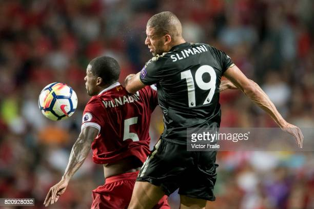 Leicester City FC forward Islam Slimani competes for the ball with Liverpool FC midfielder Georginio Wijnaldum during the Premier League Asia Trophy...