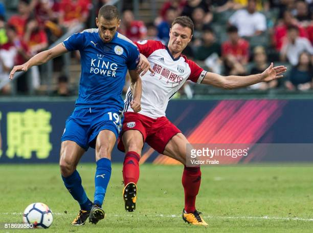 Leicester City FC forward Islam Slimani fights for the ball with West Bromwich Albion defender Jonny Evans during the Premier League Asia Trophy...