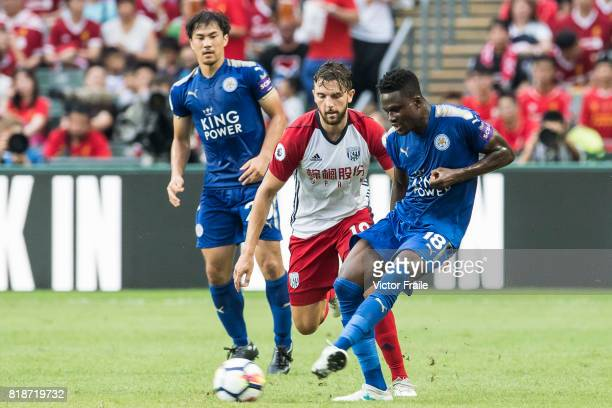 Leicester City FC midfielder Daniel Amartey battles for the ball with West Bromwich Albion forward Jay Rodriguez during the Premier League Asia...