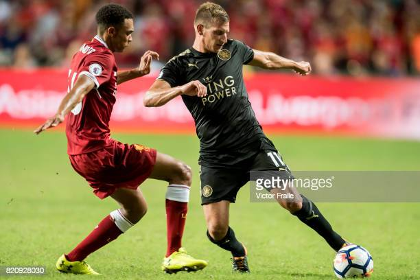 Leicester City FC midfielder Marc Albrighton fights for the ball with Liverpool FC defender Trent AlexanderArnold during the Premier League Asia...