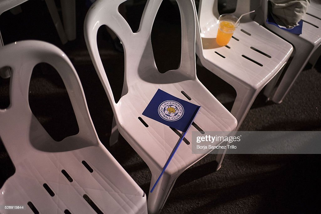 Leicester city flag is seen above an empty chair while Leicester City team plays against Manchester United on May 1, 2016 in Bangkok, Thailand. Leicester City fans gather at King Power Hotel in Bangkok to watch the Premier League game between Manchester United and Leicester City at Old Trafford.