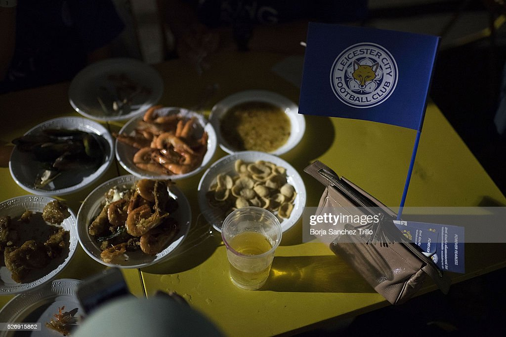 Leicester city flag is seen next to Thai food while Leicester City team plays against Manchester United on May 1, 2016 in Bangkok, Thailand. Leicester City fans gather at King Power Hotel in Bangkok to watch the Premier League game between Manchester United and Leicester City at Old Trafford.