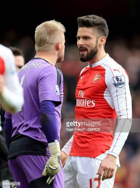 Leicester City goalkeeper Kasper Schmeichel and Arsenal's Olivier Giroud exchange words