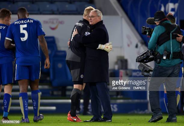 Leicester City goalkeeper Kasper Schmeichel and manager Claudio Ranieri embrace after the final whistle