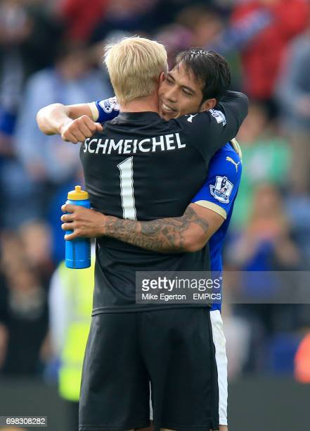 Leicester City goalkeeper Kasper Schmeichel and teammate Leonardo Ulloa celebrate victory after the final whistle