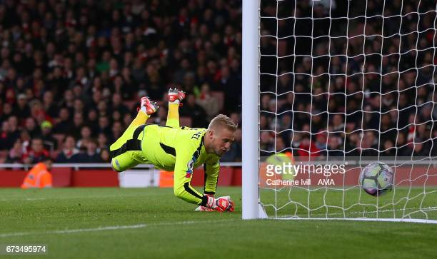 Leicester City goalkeeper Kasper Schmeichel is unable to save the shot from Nacho Monreal of Arsenal who scores a goal to make it 10 during the...