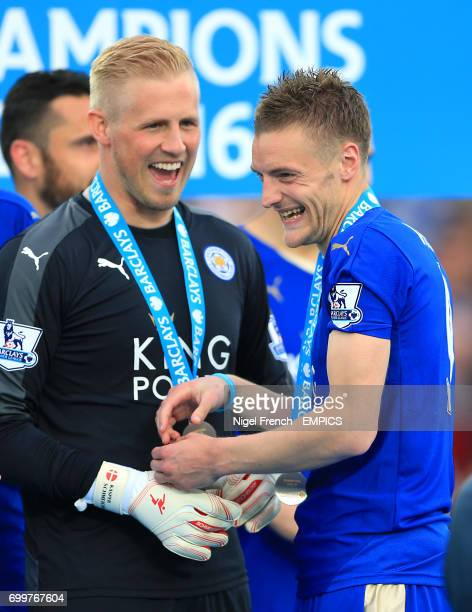 Leicester City goalkeeper Kasper Schmeichel laughs with Leicester City's Jamie Vardy