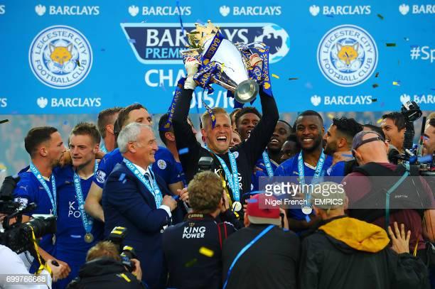 Leicester City goalkeeper Kasper Schmeichel lifts the Barclays Premier League trophy