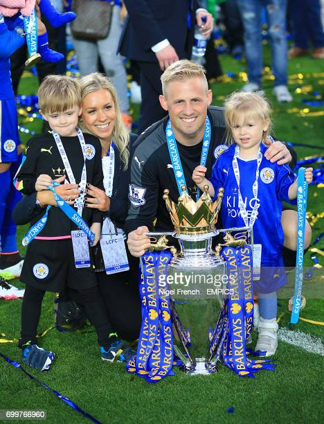 Leicester City goalkeeper Kasper Schmeichel poses with his family and the Barclays Premier League trophy