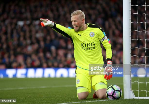 Leicester City goalkeeper Kasper Schmeichel saves a shot during the Premier League match at the Emirates Stadium London