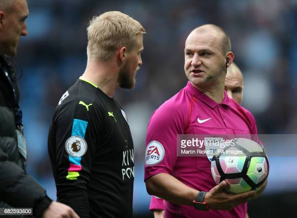 Leicester City goalkeeper Kasper Schmeichel speaks to referee Robert Madley at halftime of the Premier League match at the Etihad Stadium Manchester