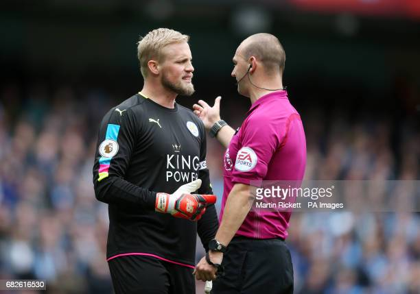 Leicester City goalkeeper Kasper Schmeichel speaks with referee Robert Madley during the Premier League match at the Etihad Stadium Manchester