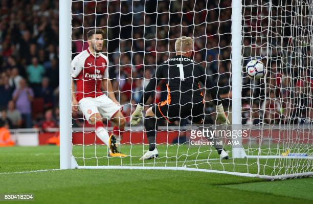 Leicester City goalkeeper Kasper Schmeichel watches as the shot from Olivier Giroud of Arsenal crosses the line to score a goal to make it 43 during...