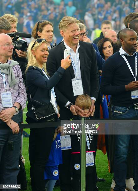 Leicester City goalkeeper Kasper Schmeichel's father Peter Schmeichel watches his son lift the Barclays Premier League trophy