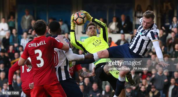 Leicester City goalkeeper RonRobert Zieler and Millwall's Aiden O'Brien battle for the ball during the Emirates FA Cup Fifth Round match at The Den...