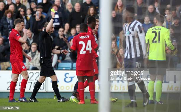 Leicester City goalkeeper RonRobert Zieler is given a yellow card during the Emirates FA Cup Fifth Round match at The Den Millwall