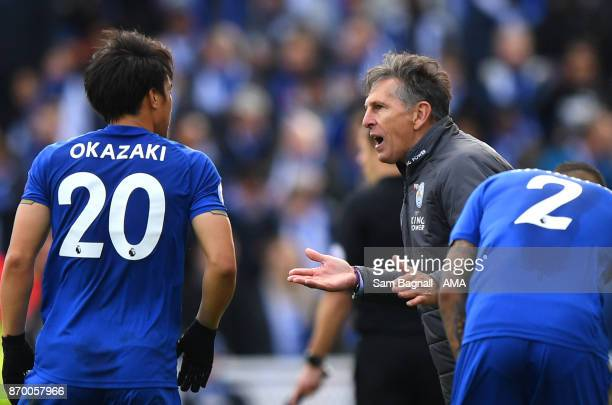 Leicester City manager Claude Puel speaks with Shinji Okazaki of Leicester City during the Premier League match between Stoke City and Leicester City...