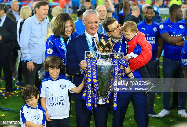 Leicester City manager Claudio Ranieri and family pose with the Barclays Premier League trophy